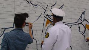 Emily Squires at community paint day at the W.E.B. Du Bois and Engine 11 mural. Image provided by Haftom Khasai