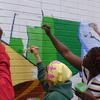 Community paint day at the W.E.B. Du Bois and Engine 11 mural. Image provided by Haftom Khasai