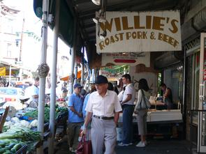 Stalls at 9th Street Market and Sign for Willie's Roast Pork and Beef. Image provided by Historical Society of Pennsylvania