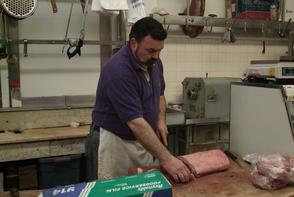 Sonny D'Angelo cutting meat. Image provided by Historical Society of Pennsylvania