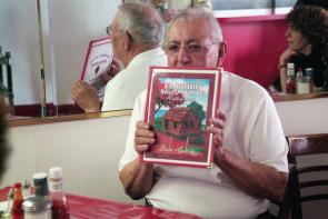 Rosa Reyes with El Bohio menu. Image provided by Historical Society of Pennsylvania