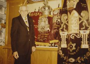 Sidney Lewis with Torahs. Image provided by Elaine Ellison