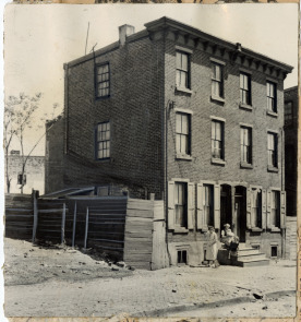 Mrs. Bella Iveson outside her home at 111 Washington Ave