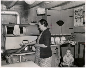 Mrs. George Merchel and her grandson George inside their home at 123 Queen St.