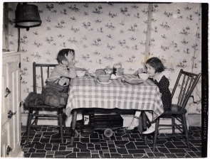 Freddie Iveson, 7, and sister Joan, 5, eat in their bandbox house at 111 Washington Ave.