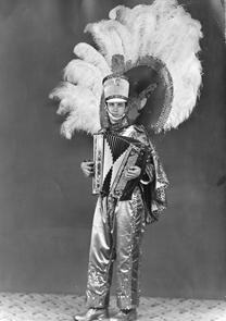 Joe Figurski in Mummer costume with accordion. Image provided by Joe Figurski