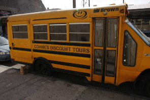 "Connie's Ric-Rac Yelllow Bus : ""Discount Tours"""