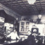 Ray, standing behind the bar on the far left, opened his business in 1938.
