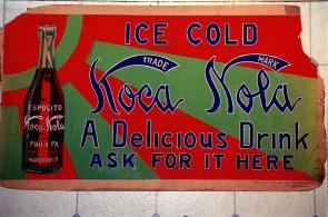 An antique sign for the old Koca-Nola soda