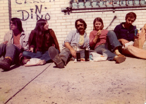 Randy Atkinson, Sandy Pearly, Joel Spivak, Lovegrove Hunter and Rob Stewart take their lunch on the sidewalk.