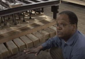 Institutional development director Milo Morris describes the crowing process of a soundboard
