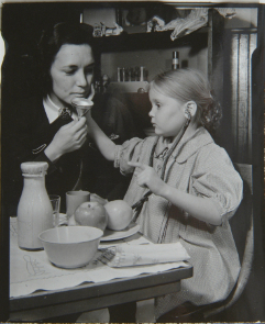 An photo of a hearing impaired student being instructed by a teacher at the Pennsylvania School for the Deaf