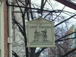 A welcome sign above the City Tavern restaurant