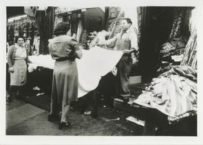 Max Krasnow selling yard goods outside his store. Image provided by Elaine Ellison